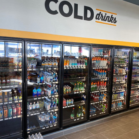 Convenience store cooler filled with drinks that was installed by Rapid Refrigeration